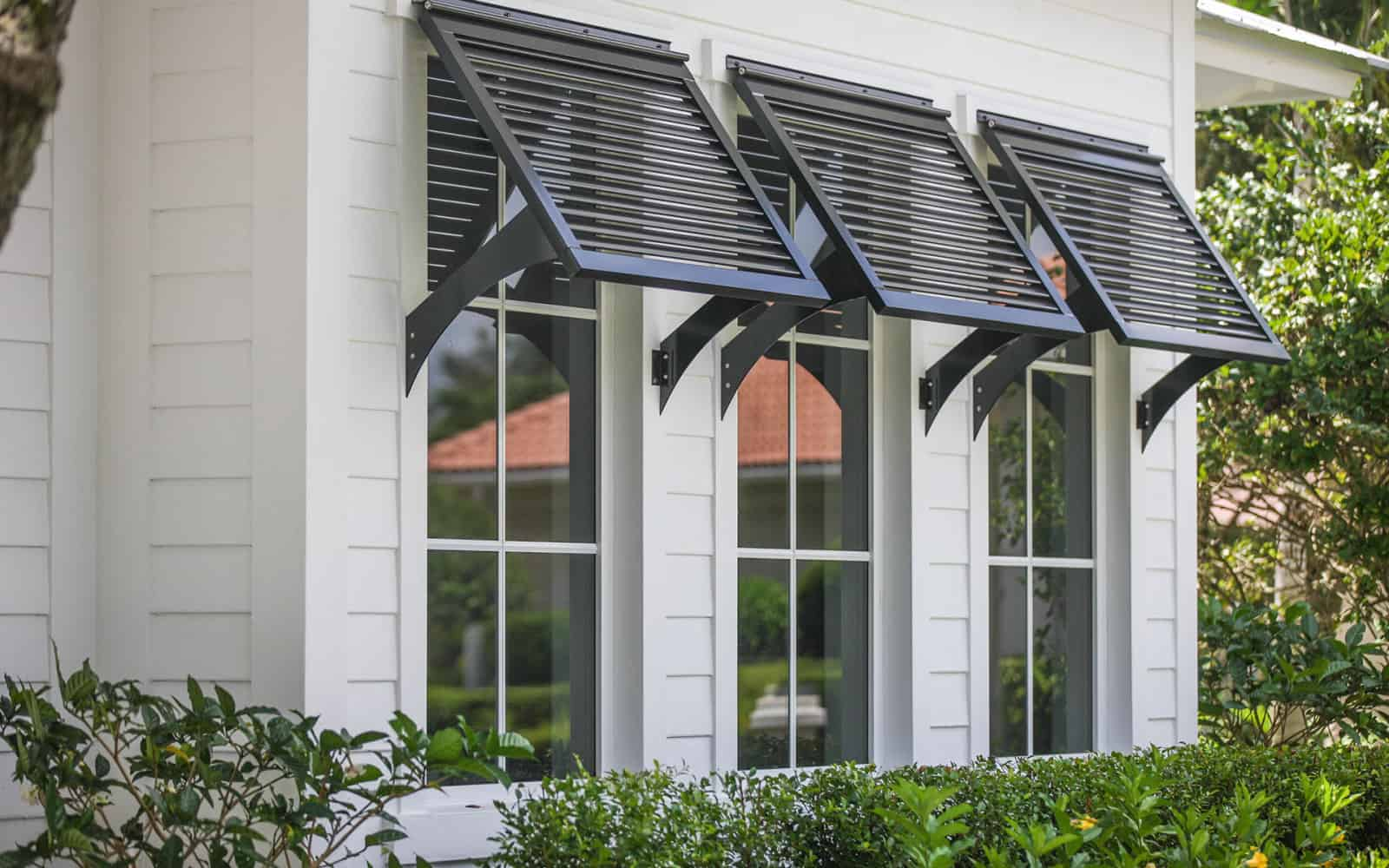 Bahama shutters by marc julien homes - Pictures of exterior shutters on homes ...