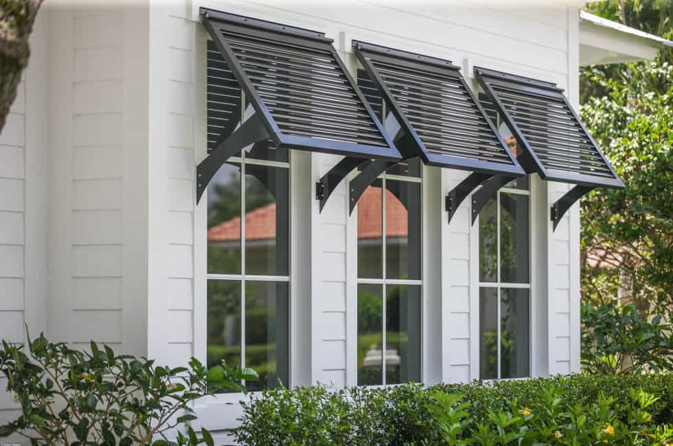 Bahama shutters by marc julien homes for Best price wood windows