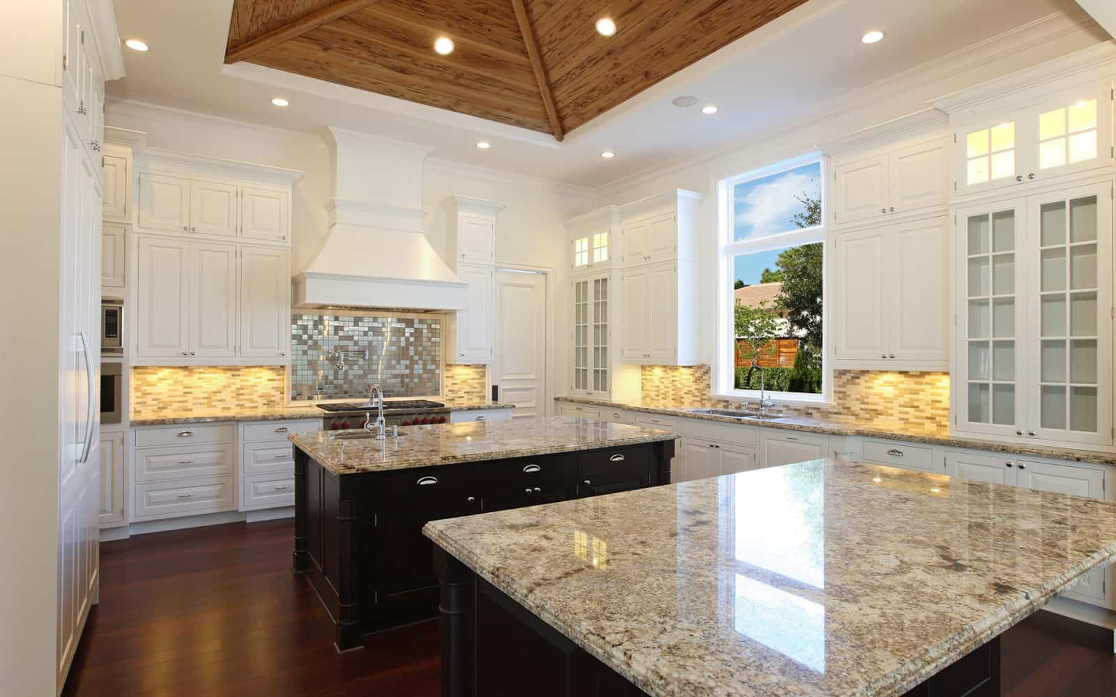 Custom ceiling details by marc julien homes for Double island kitchen